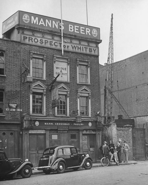 The Prospect Of Whitby [shown here in 1940] at №57 Wapping Wall E1, is London's oldest riverside pub, dating back to 1520. Most areas of the pub have spectacular views over the Thames, including the beer garden, first-floor balcony, and terrace. The pub was originally frequented by those involved in life on the river and sea; it was a notorious haunt for smugglers, thieves, and pirates.