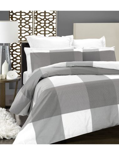 This 250 thread count cotton sateen duvet cover set features bold, geometric squares with fine pin stripe detail.