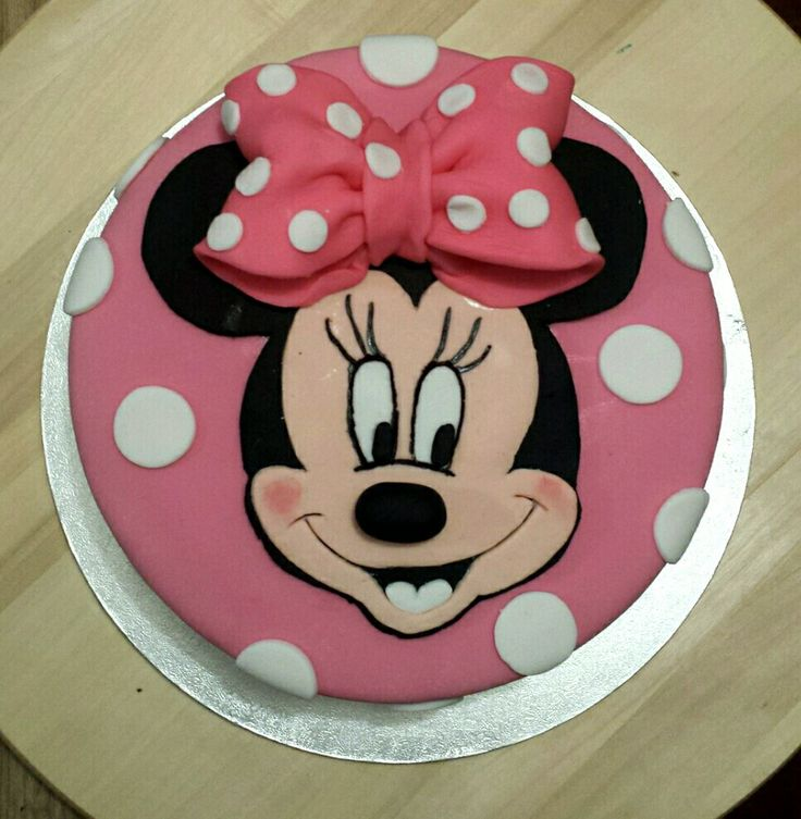 Minnie mouse cake.  Fondant icing face with 3D nose and bow.