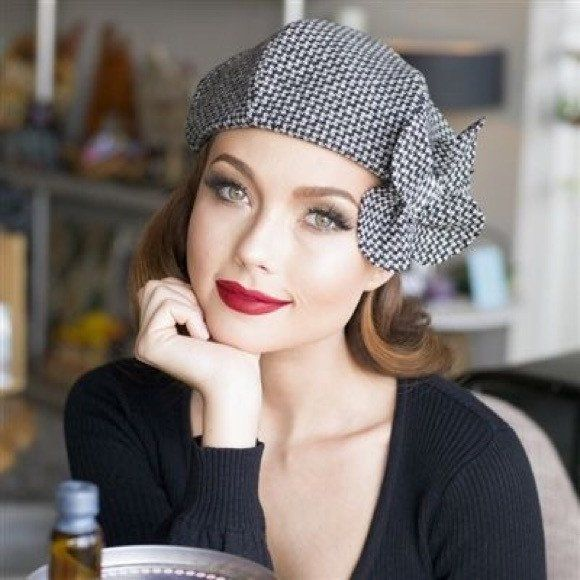 Frenchie Beret hat is made from Herringbone Wool, wool flower, lined in black taffeta, vintage button,the top of the hat has 6 section crown and has a elastic band inside. Frenchie Beret fits comforta