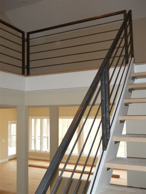 Metal stair rail -something like this with a wooden handrail may give you the horizontal line you like