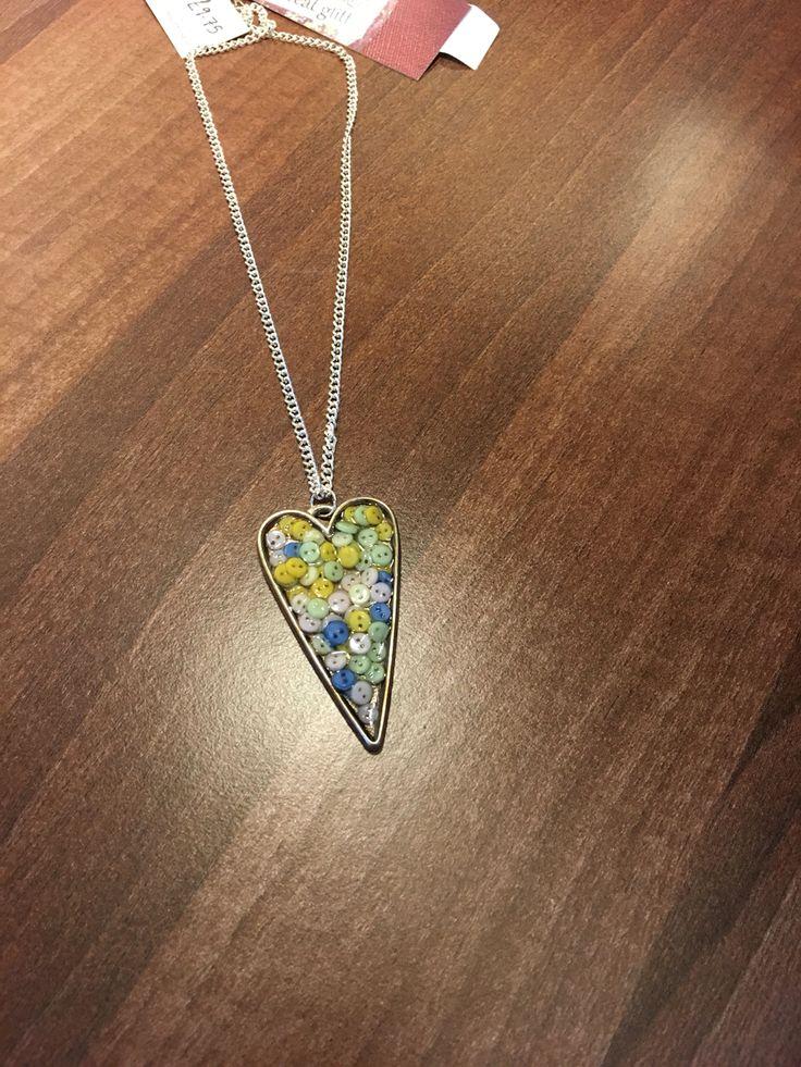 Locally handmade mini button necklace.