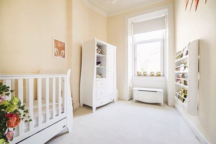 Bess's apricot, coral and gold nursery.  Wardrobe and  Sleigh Cot from Tutti Bambini  http://www.mothercare.com/nursery-furniture/katie-2-piece-nursery-bundle-lt/LX5872.html?cgid=cat_nursery&dwvar_LX5872_color=White#prefn1=brand&prefn2=searchRefinementColour&sz=12&start=41&prefv1=Tutti+Bambini&prefv2=White  Toy Box from Made.com http://www.made.com/cara-toy-box-white  Book shelf from the Great Little Trading Company…