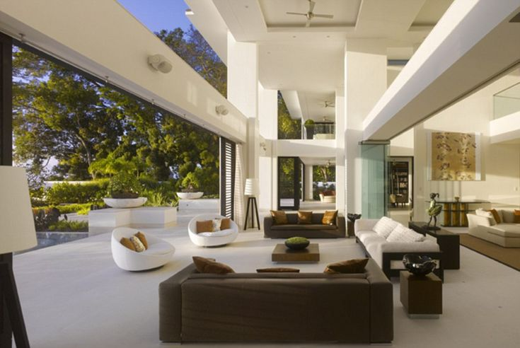 On the ground floor of the luxurious property, an open-plan living room area looks out ont...