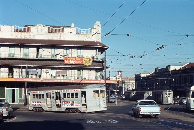 c1968 the FM tram is turning off the Victoria Bridge onto Stanley Street, South Brisbane. Nothing in is this photo still exists.