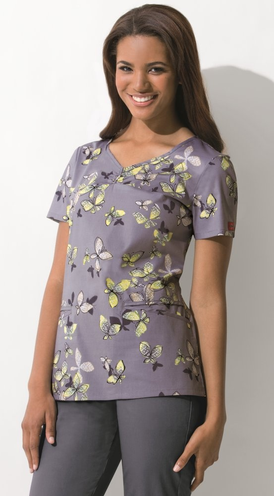 A Junior fit top features a stylized V-neck with binding at neck and angled pockets, shirring at the center front, side vents, front yoke, and back darts for shaping.