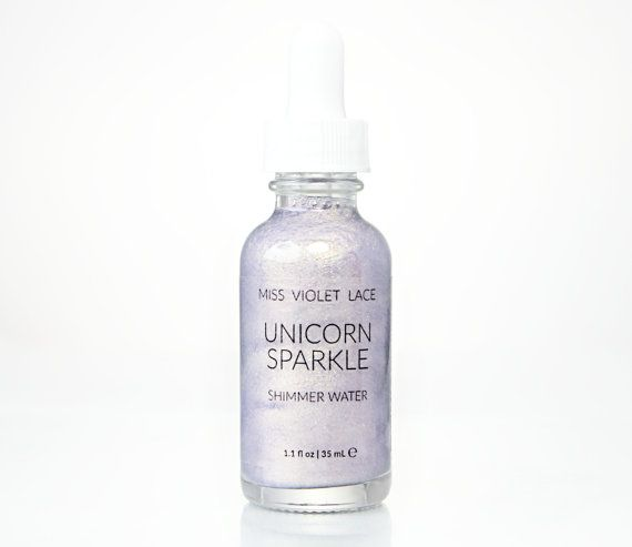 Looking for a unique stocking stuffer gift for her? This unicorn sparkle shimmer water Illuminates skin in a veil of iridescent shimmer, infused with organic extracts for majestic sparkle and sweet scent. Purple carrot extract and spirulina gives a mystical purple hue, while deeply nourishing skin and delivering beneficial vitamins. (AFF)