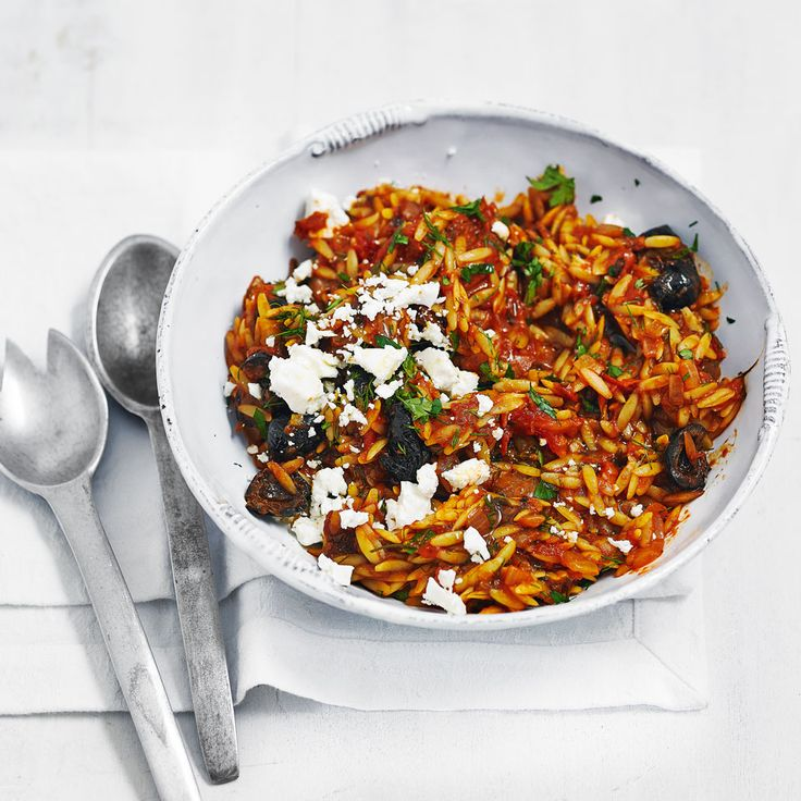 Orzo pasta with oregano, feta and tomato sauce - Orzo makes a nice change to the regular midweek bowl of pasta and this Mediterranean style recipe is a great quick dinner for vegetarians.