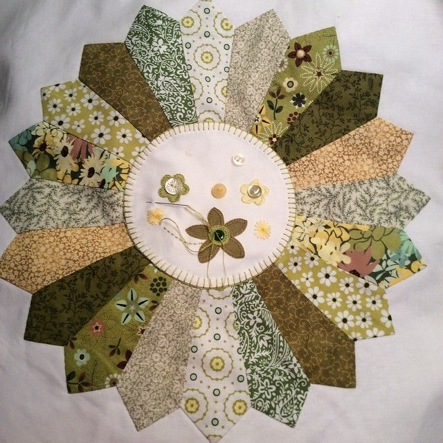 Dresden plate mini quilt in the works. I love fabric scraps!