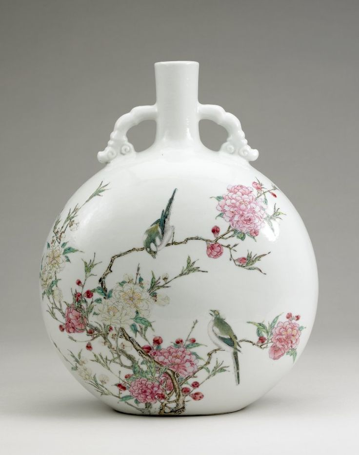 Bottle-shaped flask with flattened globular body and short narrow cylindrical neck with two cloud scroll handles joining neck and shoulder. Fine white porcelain with slightly undulating 'chicken skin' glaze painted with 'famille rose' enamels with bird and flower design. PDF 824