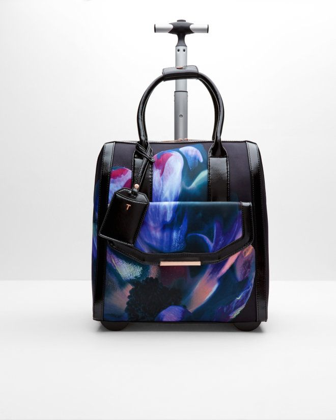 Ted Baker must be stopped! I genuinely can't cope with the craving and envy I feel whenever he bring out a new print...ON A VANITY CASE!!!! Cosmic Bloom travel bag - Black | Bags | Ted Baker UK