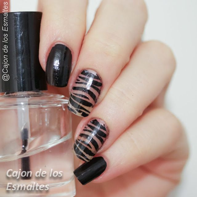 Negative space and animal print nail art
