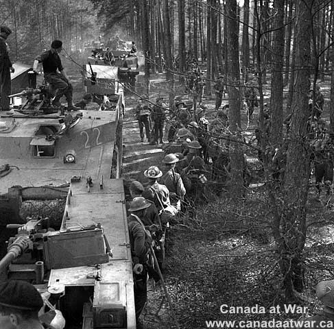 The Netherlands - Members of Princess Patricia's Canadian Light Infantry (P.P.C.L.I.) and a Buffalo amphibious vehicle used to cross the Ijssel River. 11 Apr. 1945, Zutphen, Netherlands.