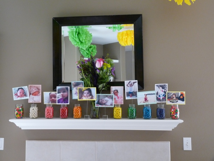 Used mason jars filled with bubble gum balls and picture wire to create a picture mantel piece. Each jar had a picture for each month of the year from Emma's birth:-)