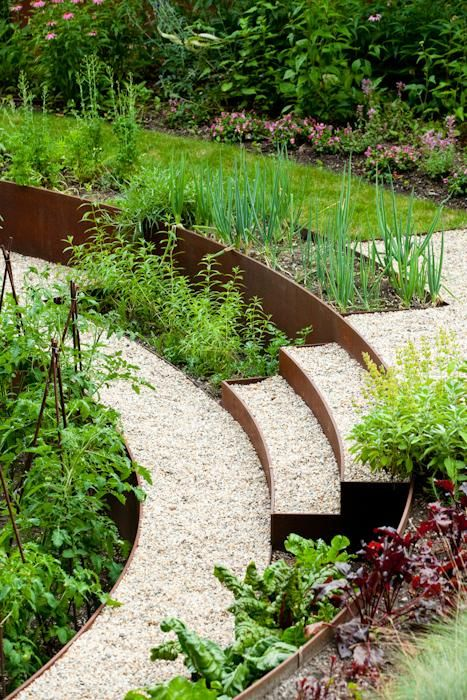 Semicircular vegetable bed formed with steel garden walls and stairs