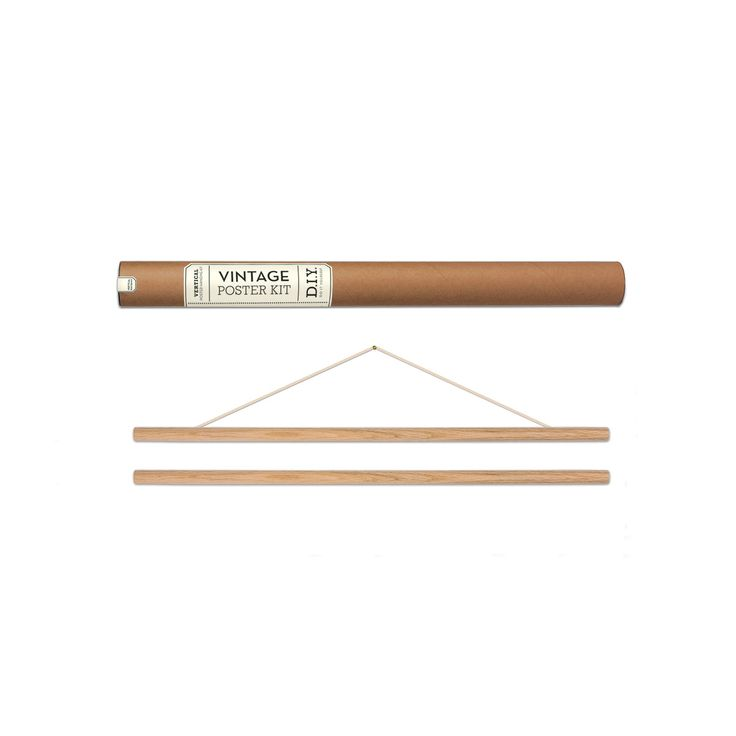 This DIY poster kit has everything you need to hang up your vintage style posters and charts. A great alternative to framing. Includes two half-round oak dowels, pre-attached cord, hanging nail, and easy-peel adhesive. Made in the USA by Cavallini. Fits 20W x 28H posters.