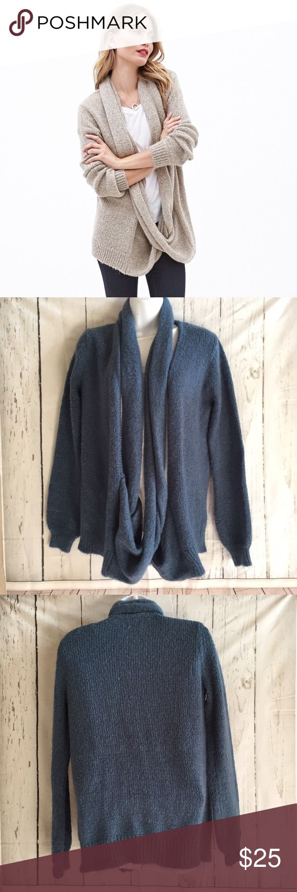 Draped Teal Scarf Cardigan First photo is a stock photo only. Teal sweater is the actual item for sale. Size XS. Brand is Forever 21 Contemporary. Acrylic, polyester and Nylon Polyamide blend. Very soft sweater. Scarf drape is not detachable. Forever 21 Sweaters Cardigans