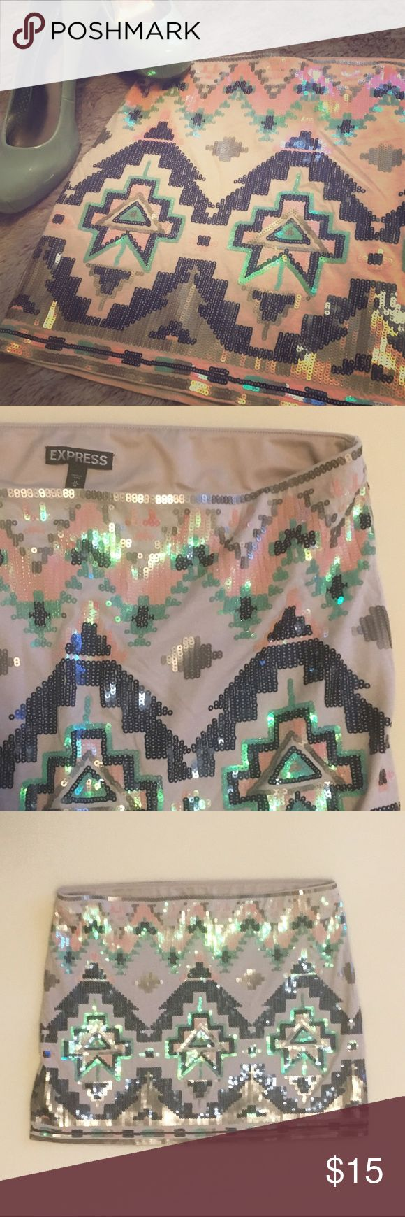 Express Geometric/ Tribal Print Sequin Mini Skirt Stretchy tan skirt with front and back sequined pattern. Worn twice, no missing sequins! Express Skirts Mini