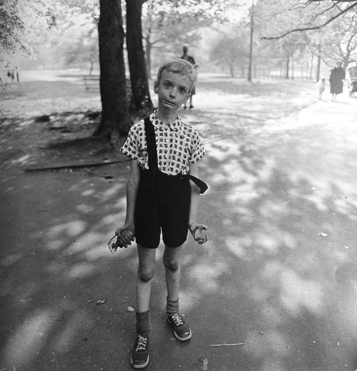 even now, upon first arriving, new york still freaks me out. pic is by diane arbus: child holding a toy hand-grenade.