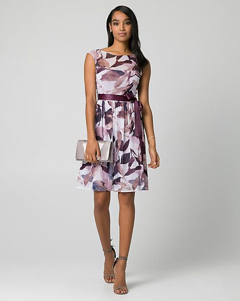 Floral Print Knit Boat Neck Dress - A self tie cinches the waist of this classically feminine boat neck dress designed with a pretty floral print. Le Chateau