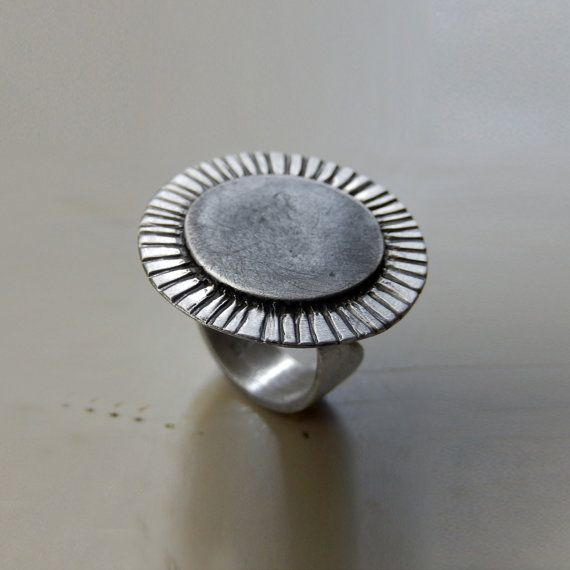 Check out this item in my Etsy shop https://www.etsy.com/listing/262767337/big-adjustable-sterling-silver-sun-ring