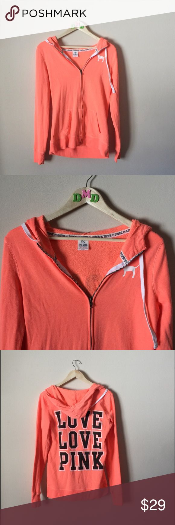 LIKE NEW • Bright neon orange PINK zipper up ♠️ This VS Pink bright neon orange zipped up hooded sweatshirt that says LOVE LOVE PINK on the back. absolutely nothing wrong with this sweatshirt at all. only been worn a handful of times.  ♠️ SIZE • x-small  ☠️ BUNDLEtoSAVE ☠️ ACCEPTING OFFERS ☠️ 〰    #pink #vs #hoodie #victoriasecret #zipperup #euc #neon #orange #bright #gym #sweat PINK Victoria's Secret Tops Sweatshirts & Hoodies