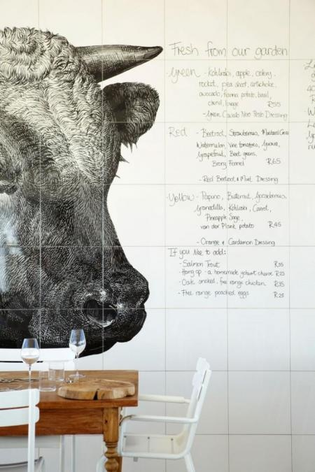 Babel restaurant - cape town. The daily menu is handwritten on large white tiles