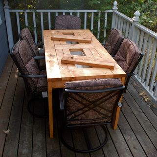 diy -patio table with built in coolers...step by step directions, tools needed, and cost. this is really cool. what a neat housewarming gift this would be!