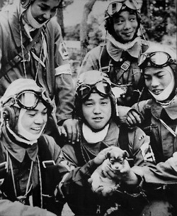 Japan. Not just pilot, but a kamikaze: 26 May 1945. Corporal Yukio Araki, holding a puppy, with four other pilots of the 72nd Shinbu Squadron at Bansei, Kagoshima. Araki died the following day, at age 17, in a suicide attack on ships near Okinawa.