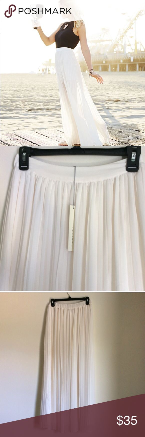"💐 NWT Lauren Conrad Ivory Pleated Maxi Skirt XS Beautiful off white cream colored skirt, measured about 39"" long. Inner liner is mini skirt length so the skirt is sheer from the knees down (see first picture). Gorgeous accordion pleats with back zipper. Bundle to save 💕 LC Lauren Conrad Skirts Maxi"