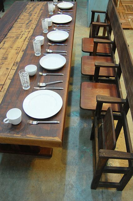 Ole wooden cinema seats as dining chairs