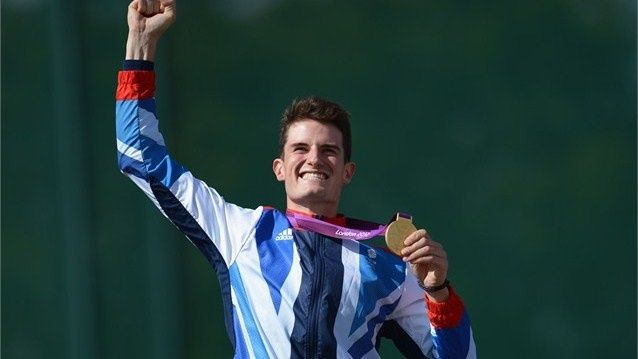 Peter Wilson of Great Britain celebrates with his gold medal during the Victory Ceremony following the men's Double Trap Shooting final on Day 6 of the London 2012 Olympic Games at the Royal Artillery Barracks.