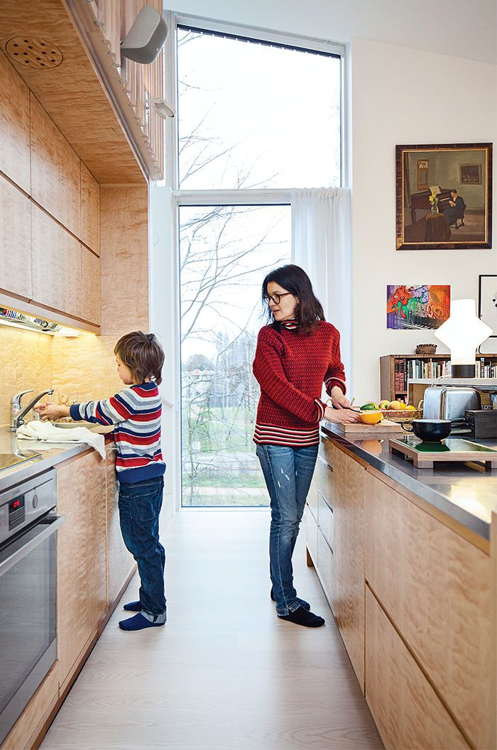 Modern home in Finland with sauna has refrigerator, AEG cooktop and oven in kitchen.  Grands tiroirs...