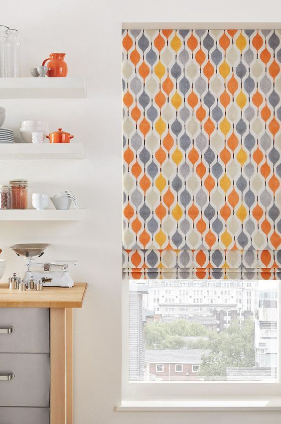Bright pop patterns brighten a decor up wonderfully in a plainly decorated kitchen, coordinate accessories to really bring the look together. Our Bauble Orange Roman blind is perfect for this.