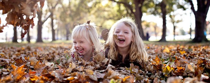 Etta ImagesPlaying in the Autumn Leaves, the best fun for a Family Portrait - Etta Images