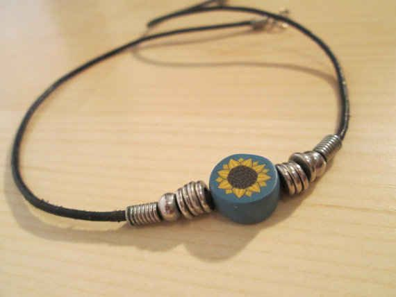 Nice sunflower/cord choker. Do you have the matching hair clips, too? | 34 Pieces Of Super '90s Jewelry