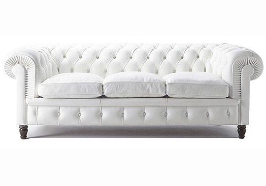 white chesterfield sofa!!!! yellow pillows on a pear green rug... parfait!