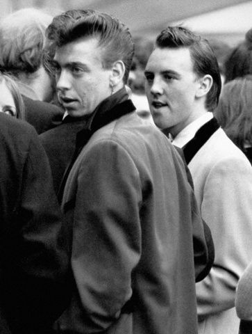 The Teddy boys tried a number of experimental hairstyles, the most favourite being the overblown quiff with a DA (ducks arse) at the back.