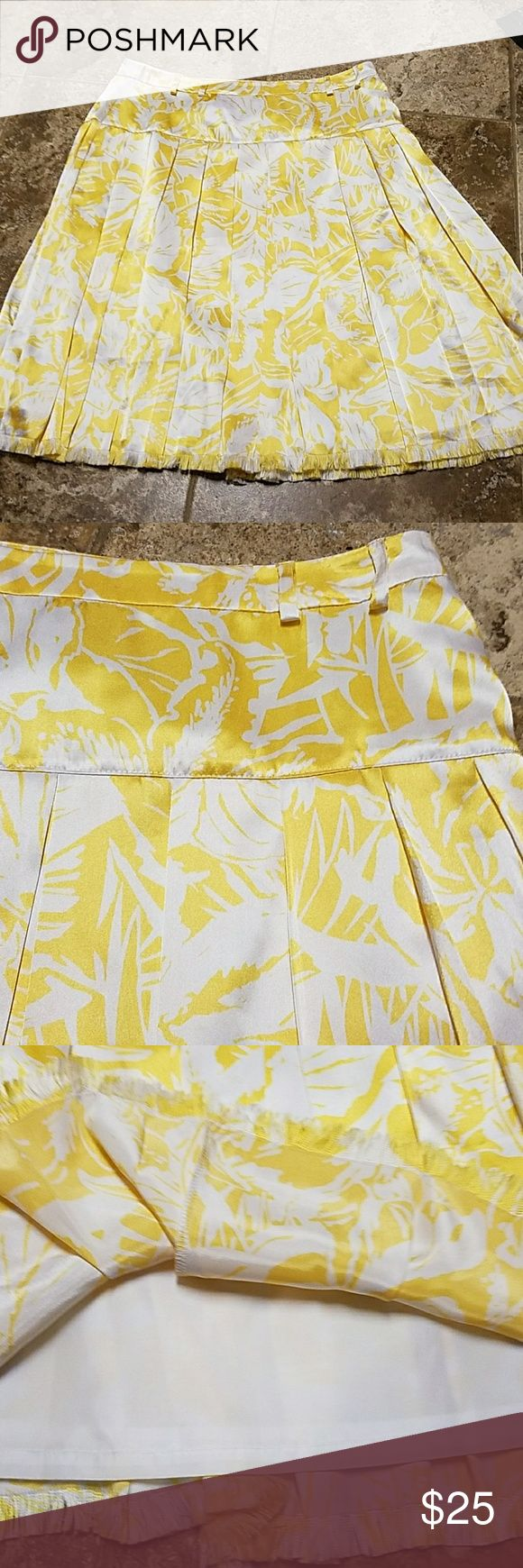 Yellow pleated skirt I loved this skirt!  I lost weight,  no longer fits.  Only was able to wear once to a wedding.  Has belt loops but no belt.  17 inches across the waist and 25 inches long.  Lots of flow and movement. Oscar de la Renta Skirts Midi