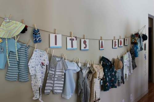 After the mama to be opens presents, hang the outfits with clothespins for all to see.