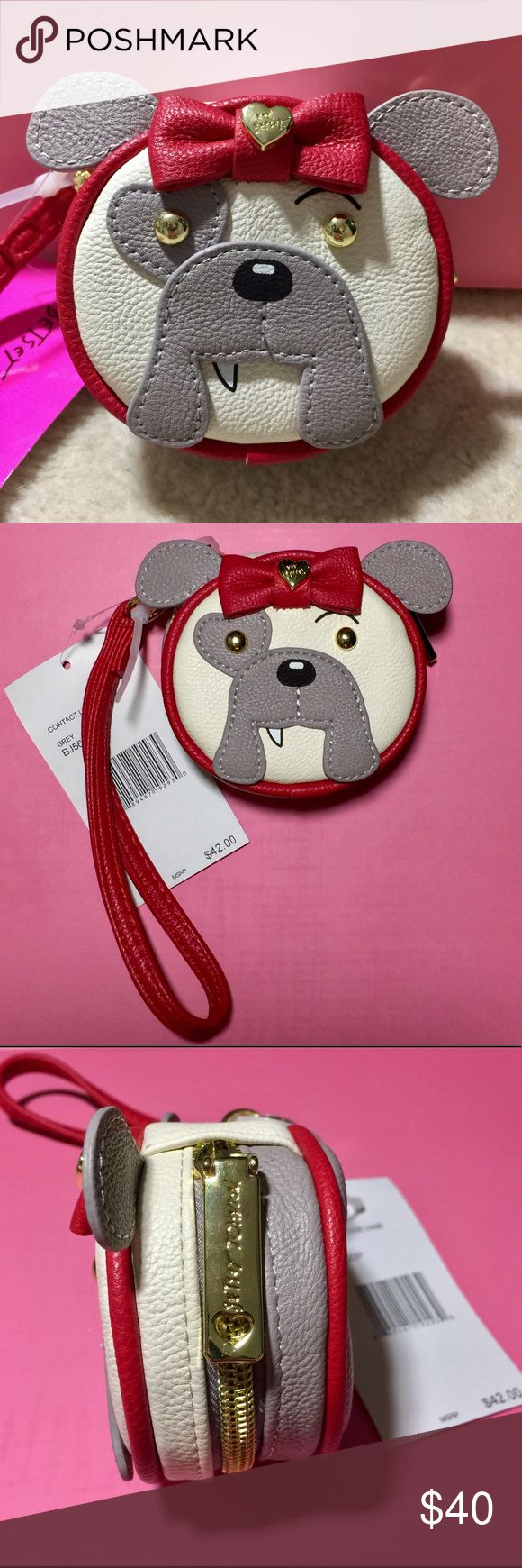 Betsey Johnson 🐶 Bulldog Contact Lens Wristlet 🐶 This is the cutest little contact lens case ever! ❤️🐶 What's more adorable than bulldog wearing a big red Betsey bow? 😍 This little guy can also be used as a coin purse, pill case or whatever your heart desires. The wristlet strap clips on so can also be removed. Open this cutie and there's two contact lens cases, little tweezers, a bottle and a mirror! Brand NWT and never used. Mirror is still covered in plastic. Paid $42.00 on Betsey's…
