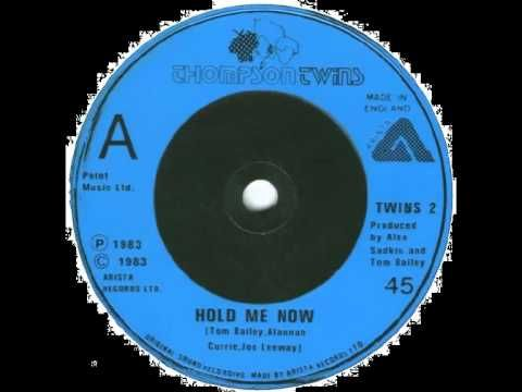 "...""Hold Me Now"" -- Thompson Twins..."
