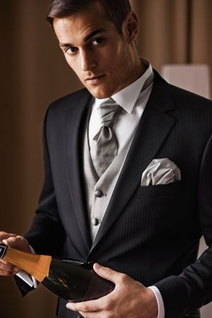 The Groom | Dark gray suit with a subtle light gray pinstripe | Tuxedo shirt and tie (color to be determined) | The vest will be switched for a more standard, non-wedding style (color to be determined)