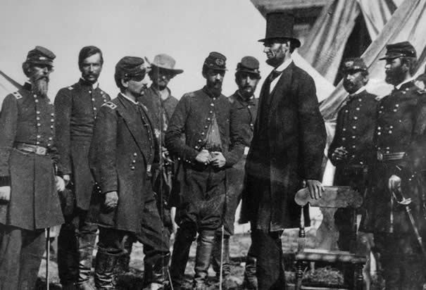 McClellan with Lincoln: President Abraham Lincoln with General George McClellan (third from left) at his headquarters in Antietam, Maryland in 1862. (Photo Credit: Bettmann/CORBIS)
