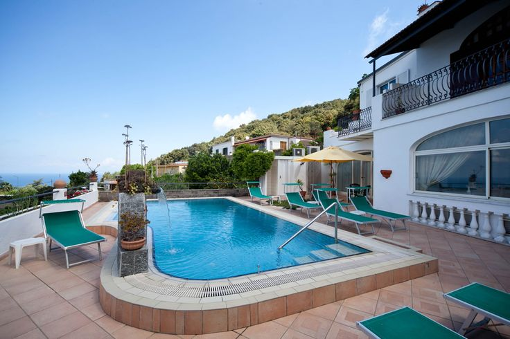 Guests can relax on the terrace offering sea views by the outdoor swimming pool.