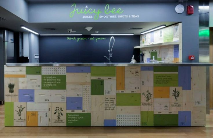 """In our """"Agora"""" the visitor will stop by JUICY BEE, the first organic juice bar in Greece that serves juices prepared by a cold press juicer thus preserving the highest possible biological value of fruit and vegetables, their vitamins, minerals and trace elements. #theAPIVITAexperienceStore #Apivita #NaturalProducts #InteriorDesign #Architecture"""