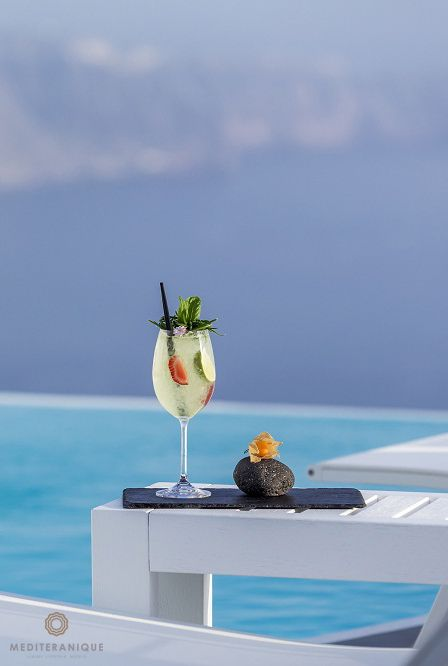 Cocktails by the infinity pool at the Chromata Hotel in Santorini, Greece
