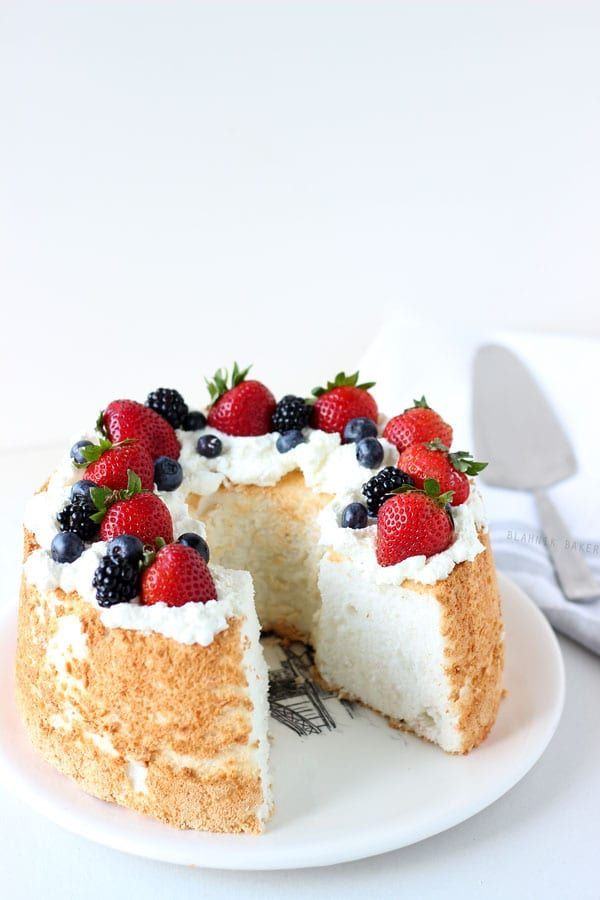Honey Coconut Angel Food Cake is sweetened with honey and given a tropical twist in this elegant summer dessert!