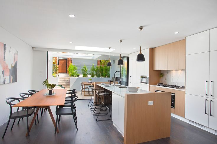Dining zone, flows to outdoor BBQ area,  superb gas kitchen, Bosch appliances, scandi look, on trend, styled, wall art, custom cabinetry, Pilcher Residential