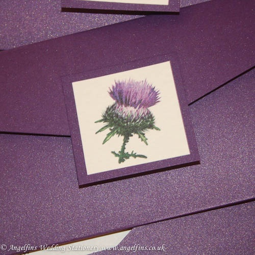 Stunning thistle photo pocketfold Invitations The wallet is made from cadburys purple shimmer card complete with additonal thistle embellishment and velcro fastenersInside there will be a white  insert attached  containing the details of your event.In the pocket there will be two card inserts which can contain information for your guests such as RSVP details, maps, accomodation or gift list